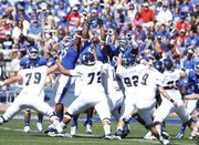 Kansas players converge but cannot block a field goal from Rice kicker Chris Boswell during the first quarter on Saturday, Sept. 8, 2012 at Memorial Stadium.