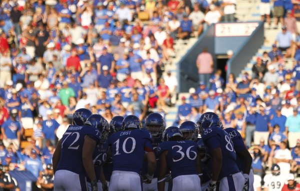 The Kansas offense huddles together late in the game against Rice during the fourth quarter on Saturday, Sept. 8, 2012 at Memorial Stadium.