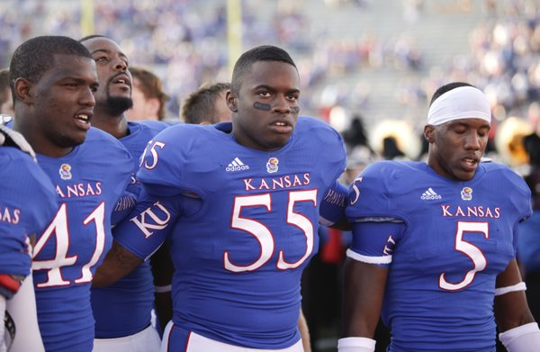 Kansas players Jimmay Mundine (41) Michael Reynolds (55) and Greg Brown (5) sing the Alma Mater to the student section following their 25-24 loss to Rice on Saturday, Sept. 8, 2012 at Memorial Stadium.