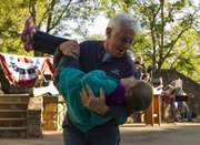 Prairie Village resident Steve Snitz dips his 6-year-old granddaughter Lela Pereira as the two dance during the Harvest Home Picnic and Music Festival on Saturday at Clinton Lake.