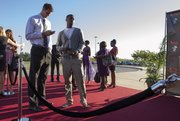 Kansas basketball players Jeff Withey, left, and Elijah Johnson, wait on the red carpet before entering the Lied Center for the Rock Chalk Choice Awards Sunday, Sept. 9, 2012.
