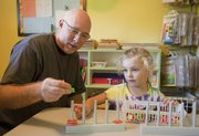 Preschool teacher james Immel sits with Lola Agre, 4, during some play time at Immel Early Education Academy on Sept. 10.