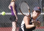 Lawrence High's Kendall Pritchard returns a shot in a home match against a Washburn Rural rival, part of a quad meet Monday, Sept. 10, 2012, at LHS.