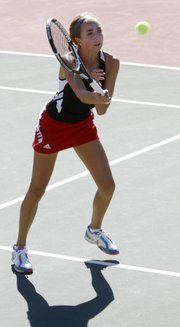 Whitney Simons, the No. 1 singles player for Lawrence High, competes in a home match against a Washburn Rural rival, part of a quad meet  Monday, Sept. 10, 2012, at LHS.