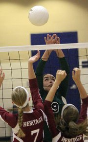 Seabury Academy senior Sarah McDermott gets up high for a return against Heritage Christian Academy on Tuesday, Sept. 11, 2012, at Seabury's home volleyball triangular.