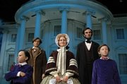 Lifelike figures of the Lincoln family stand in the Abraham Lincoln Museum Entry Plaza in Springfield, Ill.