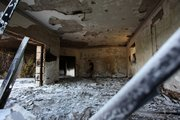 A Libyan man walks in the rubble of the damaged U.S. consulate, after an attack that killed four Americans, including Ambassador Chris Stevens on the night of Tuesday, Sept. 11, 2012, in Benghazi, Libya, Thursday, Sept. 13, 2012. The American ambassador to Libya and three other Americans were killed when a mob of protesters and gunmen overwhelmed the U.S. Consulate in Benghazi, setting fire to it in outrage over a film that ridicules Islam's Prophet Muhammad. Ambassador Chris Stevens, 52, died as he and a group of embassy employees went to the consulate to try to evacuate staff as a crowd of hundreds attacked the consulate Tuesday evening, many of them firing machine-guns and rocket-propelled grenades.