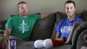Kansas University student Colby Liston, 18, sits with his father, Matt Liston, during an interview Sept. 10 at his home in Derby. Colby lost both of his legs below the knee after being pinned between two vehicles during an accident Aug. 26 on Tennessee Street. Colby says he is remaining positive and looking forward to being fitted for prosthetic legs.