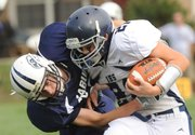 Seabury Academy junior Joe Simpson puts a tackle on Independence Home School's Nick Board, Friday, Sept. 14, 2012 at Seabury.