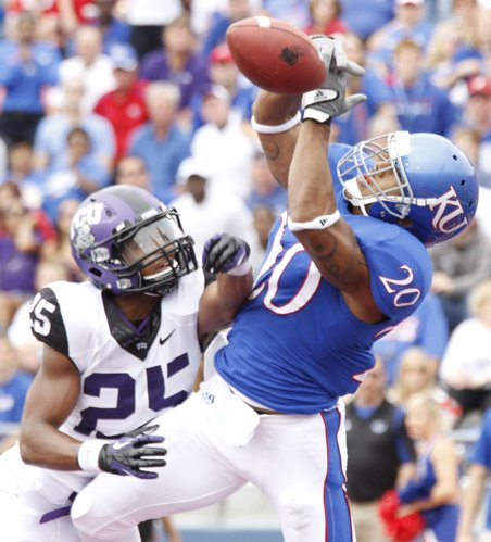 Kansas reciever D.J. Beshears (20) is unable to come up with the ball end the end zone as TCU cornerback Kevin White (25) applies pressure during their game Saturday, Sept. 15, 2012 at Memorial Stadium.