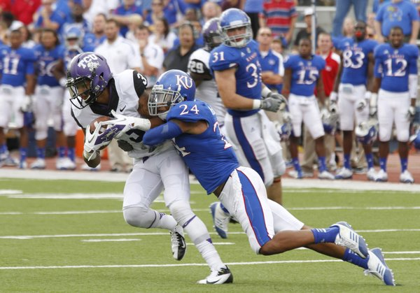 Kansas safety Bradley McDougald (24) wraps up TCU receiver Brandon Carter (3) during the fourth quarter of their game Saturday, Sept. 15, 2012 at Memorial Stadium.