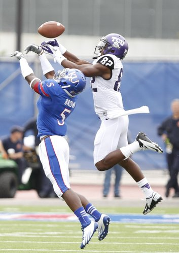 Kansas cornerback Greg Brown breaks up a pass to TCU receiver Josh Boyce during the second quarter, Saturday, Sept. 15, 2012 at Memorial Stadium.