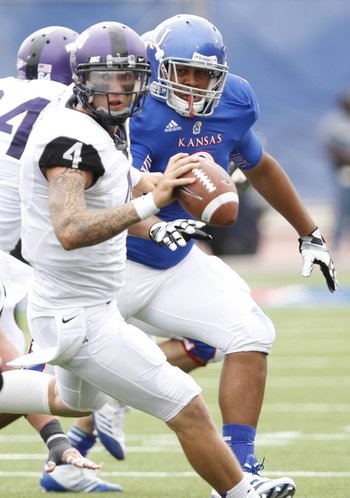 Kansas defensive lineman Jordan Tavai pressures TCU quarterback Casey Pachall during the second quarter, Saturday, Sept. 15, 2012 at Memorial Stadium.