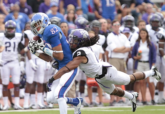 Kansas receiver Andrew Turzilli pulls in a deep pass as TCU cornerback Jason Verrett dives in for the tackle during the third quarter, Saturday, Sept. 15, 2012 at Memorial Stadium.