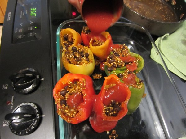 The stuffed peppers are ready to go into the oven.