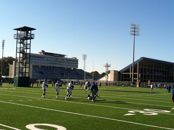 KU's wideouts run through a drill during Tuesday's practice.