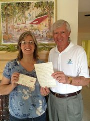 Kristyn Harnar Nieder and Bill Shunk, both of Lawrence, hold a letter that Shunk sent to Nieder on Jan. 10, 1972. At that time, Shunk was a major in the U.S. Army commanding a helicopter company in Phu Bai, Vietnam, and Nieder was a second-grade student at Broken Arrow School in Lawrence. The letter was sent in response to a letter Nieder sent as part of a second-grade project sending mail to active military personnel in the war zone. Shunk's daughter, Mandy, was also in Broken Arrow's second-grade class at that time. Nieder saved the original letter and has used it for many years in her history classes in the Lawrence school district. Nieder currently teaches at West Middle School. Shunk submitted the photo.