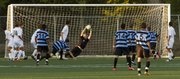 Free State senior goalkeeper Luke Leslie makes a diving save during the first half of the Firebirds' soccer match against Shawnee Mission East, Tuesday, Sept. 18, 2012, at FSHS.