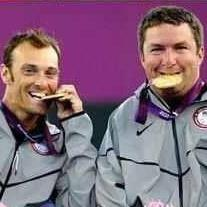 Nick Taylor, right, and his Quad Doubles Partner David Wagner, bite their Gold Medals in celebration at the 2012 London Paralympics.
