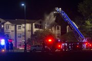 Firefighters respond Wednesday night to a fire at Berkeley Flats apartments, in the 1100 block of Indiana Street. There were no injuries reported in the blaze, but 14 residents were displaced.