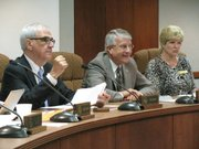 The Kansas Board of Regents on Thursday recommended a $47.1 million budget increase for higher education. Pictured from left to right at the meeting are Kansas Board of Regents Chairman Tim Emert of Independence, Chief Executive Officer Andy Tompkins, and Regent Robba Moran of Hays.