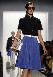 The Michael Kors Spring 2013 collection is modeled Sept. 12 during Fashion Week in New York. Designers filled the runways with clothes that the everyday Midwest woman could have taken directly off the model and worn the next day without any weird glances thrown her way. 