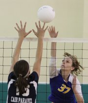 Veritas Christian School&#39;s Lacey Billings spikes the ball over Cair Paravel&#39;s Peyton Williams during the second set on Thursday, Sept. 20, 2012 at the Eudora Community Center.
