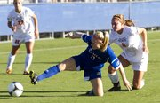 Kansas' Sarah Robbins gets low to keep the ball away from Oklahoma State's Kelsey Bass (4) during their soccer match Friday, Sept 21, 2012, at the Jayhawk Soccer Complex.