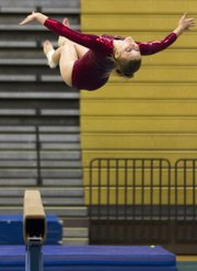 Lawrence High gymnast Allison Williams performs a backflip off the balance beam during her meet on Saturday, Sept. 22, 2012, at Free State High School.