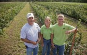 The Gieringers Orchard, near Edgerton, will be on the Kaw Valley Farm Tour the weekend of Oct. 6. Pictured in their blackberry field, which will produce fruit next year and be a you-pick crop for customers, from left are owners Frank and Melanie Gieringer and their son, Brice Wiswell.