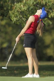 Kansas' Meghan Potee reacts to narrowly missing a long putt on the sixth green Monday, Sept. 24, 2012, at Alvamar Golf and Country Club.