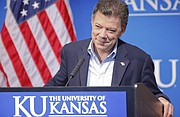 Colombian President Juan Manuel Santos listens to a question at a news conference on Monday, Sept. 24, 2012, at the Lied Center pavilion in Lawrence. Santos, a 1973 graduate of KU, visited the university before a meeting with the United Nations General Assembly in New York.