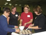 2011 Cooking 101 participants learn how to properly measure ingredients as they prepare muffins.
