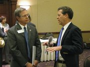 Kansas University Provost Jeff Vitter and Gov. Sam Brownback talk Tuesday prior to the start of meeting of Governor&#39;s Council of Economic Advisors that was held at the Kansas State University Alumni Center in Manhattan.