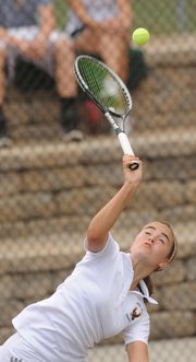Free State's Megan McReynolds makes a hard serve to Lawrence High defenders in a match on Tuesday, Sept. 25, 2012, at LHS.