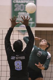 Bishop Seabury's Sarah McDermott looks to spike over University Academy's Ke'Auna Schiele during the second set on Tuesday, Sept. 25, 2012, at Bishop Seabury Academy. McDermott had 10 kills and nine assists as the Seahawks won, 3-0.