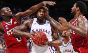 Kansas forward Thomas Robinson gets some contact from North Carolina State forwards DeShaun Painter (0) and Richard Howell during the first half on Friday, March 23, 2012 at the Edward Jones Dome in St. Louis.