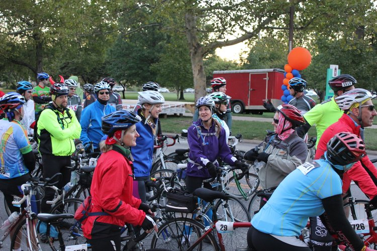Lawrence Journal-World health reporter Karrey Britt, center, visits with Go! editor Katie Bean, left, and Team Droopy captain Krissie Druen, at right in a red helmet, while waiting at the start line for Day 2 of the Kansas City MS Bike ride, which raises awareness about multiple sclerosis and funding for the National MS Society. Bean and Britt opted to do the 71-mile ride, which started on Massachusetts street near South Park and ended at Garmin International in Olathe. Druen finished the 38-mile ride.