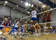 Kansas University's Tiana Dockery sends a shot past Iowa State's Jamie Straube (14) and Victoria Hurtt (10) during the Jayhawks' volleyball match against No. 19 Iowa State on Wednesday, Sept. 26, 2012 at Horejsi Center.