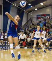 Kansas University's Brianne Riley (3) makes a play on the ball while teammates Morgan Boub (6) and Tiana Dockery (7) watch during the Jayhawks' volleyball match against No. 19 Iowa State on Wednesday, Sept. 26, 2012 at Horejsi Center.