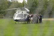 First responders load a patient onto an air ambulance at Hobbs Park at about 9:30 am on Sept. 26, 2012, after the patient was injured in the 900 block of New Hampshire street.