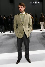 A model shows off the layered look with a white collard shirt, V-neck sweater and blazer during the Perry Ellis Fall 2005 Collection, held Feb. 4, 2005, at Byrant Park in New York.