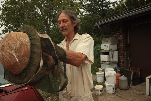 Richard Bean, who lives near Baldwin and owns Blossom Trail Bee Ranch, gets ready to check his hives.