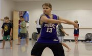 Ten-year-old Bowen Boyack, Lawrence, watches himself in a mirror as he practices his dance routine Sept. 14 in the Athletic Movement Training for Boys and Young Men class at Lawrence Arts Center, 940 N.H.