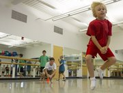 Eight-year-old Christopher Howard, Lawrence, leaps across the floor during an Athletic Movement class Sept. 14 at the Lawrence Arts Center, 940 N.H.