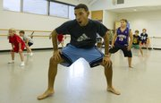 Instructor Matt Rodriguez, Lawrence, goes through a dance routine with his students in his Athletic Movement for Boys and Young Men class Friday, Sept. 14, 2012, at the Lawrence Arts Center, 940 N.H.