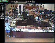 These images taken from Surveillance video from Jayhawk Pawn and Jewelry, 1084 W. Sixth St., shows two men suspected of stealing three guns from the store Thursday afternoon.