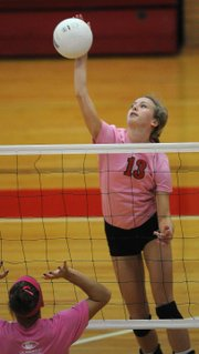 Lawrence High's Caroline Dykes slams a return against Dodge City during the Joan L. Wells Invitational on Saturday, Sept. 29, 2012, at LHS.