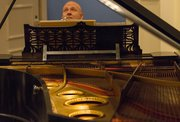 Pianist and Kansas University professor Steven Spooner performs a 20-minute concert during a release party for his 5-CD set Sept. 22 at the Spencer Museum of Art. Spooner is playing an 1886 Bechstein concert grand piano that was once owned by composer Franz Liszt.