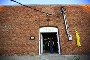 A visitor enters the Seedco Studios, 826 Pennsylvania, Friday, Sept. 28, 2012 at the Warehouse Arts District.